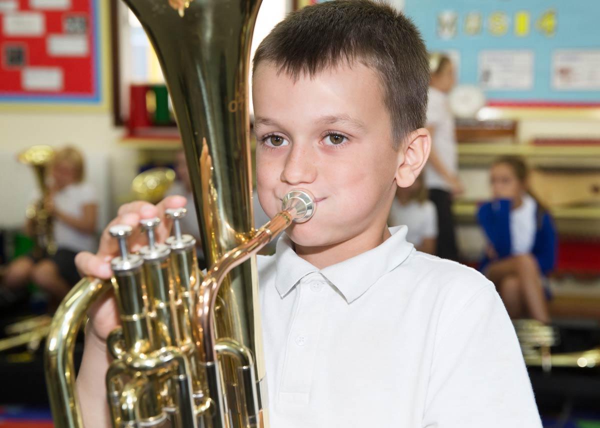 Boy playing instrument